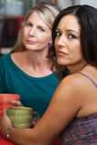Concerned Ladies in Coffeehouse Stock Photos