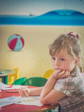 Concerned little girl coloring fox Royalty Free Stock Photo