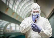 Concerned Man Wearing HAZMAT Protective Suit Holding Blood Test Tube Royalty Free Stock Photo