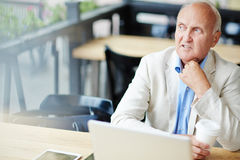 Concerned Mature Businessman in Cafe Royalty Free Stock Photo