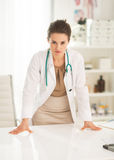 Concerned medical doctor woman in office Royalty Free Stock Images