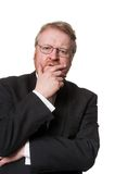 Concerned middle aged man in tuxedo on white Stock Photography