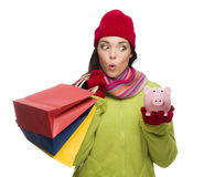 Concerned Mixed Race Woman Holding Shopping Bags and Piggybank Royalty Free Stock Photos