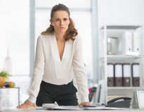 Concerned modern business woman in office Royalty Free Stock Photo