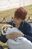 A concerned pet owner holding her dog in a blanket near the El Rincon, Cuba Stock Photo