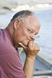 Concerned Retired Man. A retired man thinking deeply about his future Stock Images
