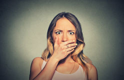 Concerned scared shocked woman covering her mouth Stock Photo