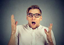 Concerned scared young man in glasses Royalty Free Stock Photo
