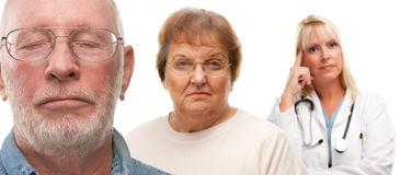 Concerned Senior Couple and Female Doctor Behind. With Selective Focus the Gentleman in front Royalty Free Stock Images