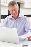 Concerned Senior Man Looking At Finances On Laptop Royalty Free Stock Photography