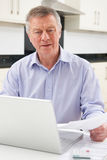 Concerned Senior Man Looking At Personal Finances Stock Photo