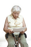 Concerned senior reading letter Royalty Free Stock Photo