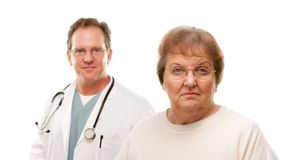 Concerned Senior Woman with Doctor Behind Royalty Free Stock Photos