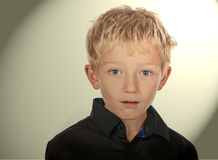 A concerned and shocked little boy. A concerned and shocked little blonde boy child Stock Photo