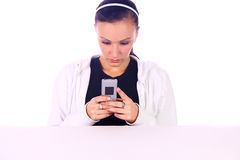 Concerned Teenage Girl Texting Royalty Free Stock Photography