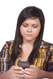 Concerned Teenage Girl Texting Royalty Free Stock Photo