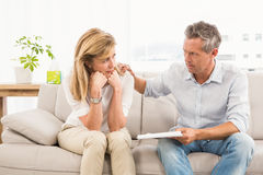 Concerned therapist comforting female patient Stock Photography