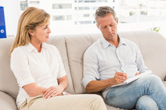 Concerned therapist talking with female patient Royalty Free Stock Images