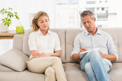 Concerned therapist talking with female patient Royalty Free Stock Image