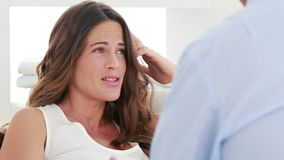 Concerned therapist talking with a pregnant woman stock footage