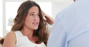 Concerned therapist talking with a pregnant woman
