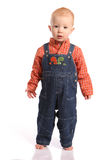 Concerned Toddler In Overalls Royalty Free Stock Image