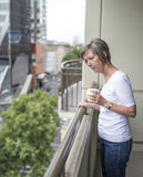 Concerned Woman on Balcony. Stock Photo