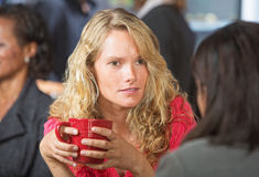 Concerned Woman in Cafe Royalty Free Stock Photography