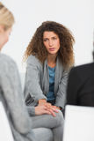 Concerned woman comforting another in rehab group at therapy Stock Photo