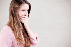 Concerned Woman Covering Mouth Royalty Free Stock Photography