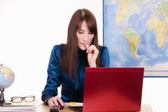 Concerned woman - an employee of a travel agency Stock Photo