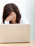 Concerned woman with a laptop Stock Photos