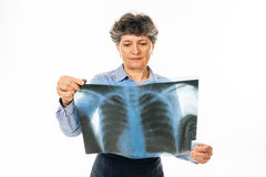 Concerned woman looking at radiography Stock Image