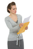 Concerned woman reading letter Stock Photography