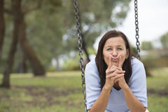 Concerned worried mature woman outdoor Stock Image