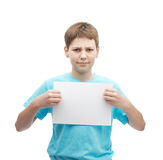 Concerned young boy with a sheet of paper Royalty Free Stock Photography