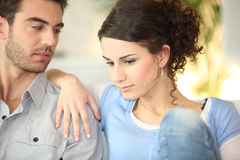 Concerned young couple Stock Photo