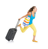 Concerned tourist woman with wheel bag rushing Royalty Free Stock Photo