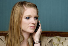 Concerned Young Woman on Cell Phone Stock Photography