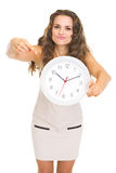 Concerned young woman pointing on clock Stock Image
