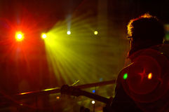 Concert. Guitar player, concert color lights Stock Photo