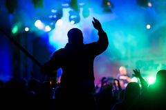 At concert. Silhouettes against stage lighting at concert Royalty Free Stock Photos