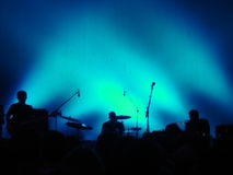 Concert. Silhouettes of a band against a blue background Stock Photo