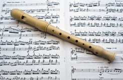 After concert. Flute on a musical paper Royalty Free Stock Photos