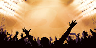 Concert audience. With hands spreading up Royalty Free Stock Photography