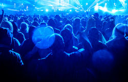 Concert Audience. Heavy metal concert audience enjoying music in the rain Royalty Free Stock Image