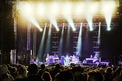 Concert audience. Concert lights on stage with audience watching Royalty Free Stock Image