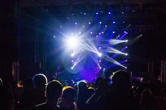 Concert audience. Live concert audience silhouettes and stage lights Stock Photo