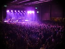 Concert audience, with stage lights and colors Stock Photography