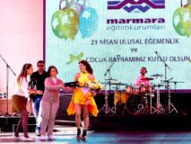 Concert ceremony. Singer Atiye performs for the children during National Sovereignty and Children Day on April 22, 2012 in Istanbul.  Pop star Atiye with Royalty Free Stock Photo